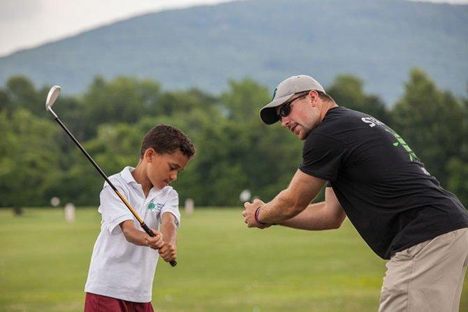 world sports camp golf boy instructor