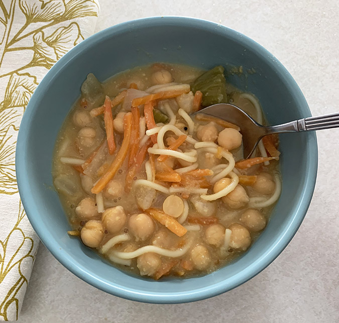 hearty chickpea soup serving in a bowl fountainof30