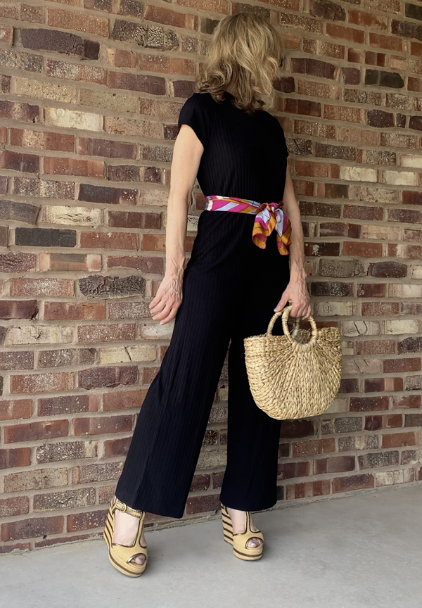 black jumpsuit outfit straw bag fountainof30