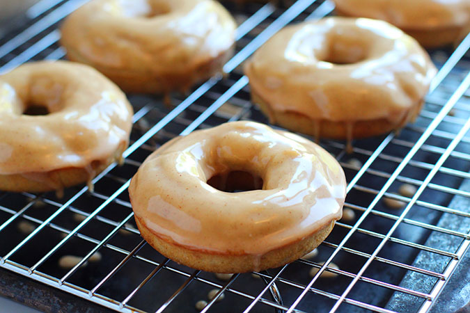 warm apple baked donuts on a rack