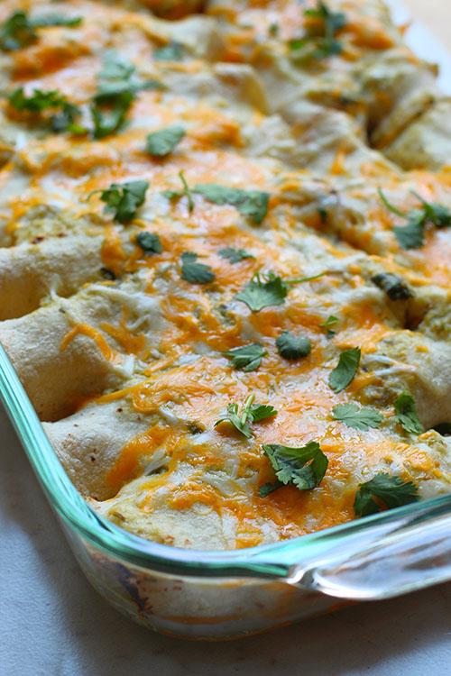 salsa verde chicken enchiladas in glass pan fountainof30