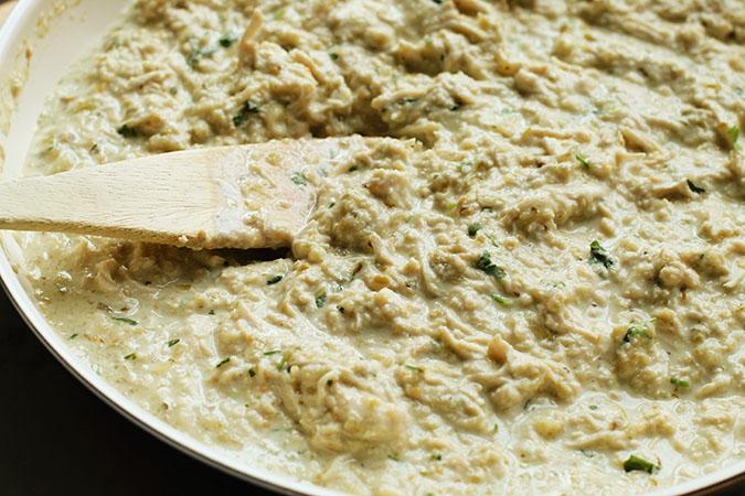 stirring salsa verde chicken enchiladas fountainof30