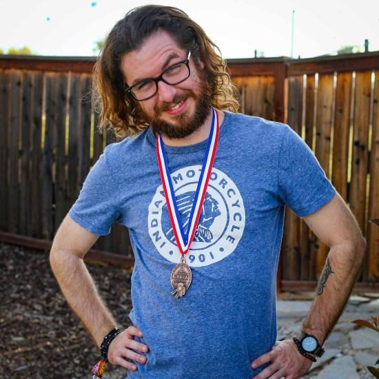 Matt Becker Wearing His Bronze Medal from GABF