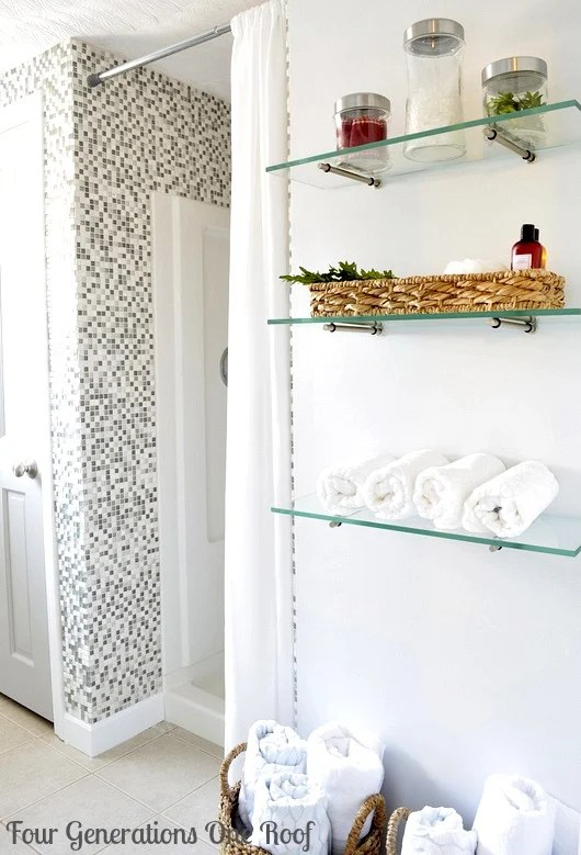 Easy organization projects DIY budget bathroom renovation glass shelving