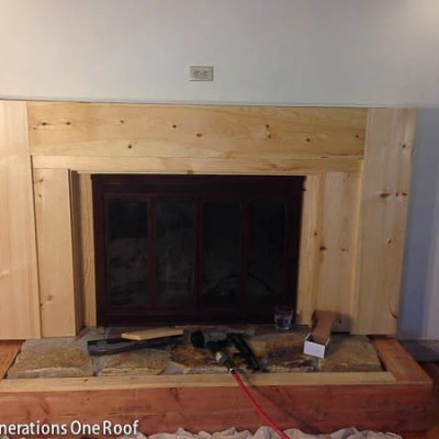 Our fireplace makeover stage 3 {covering the stone with wood}