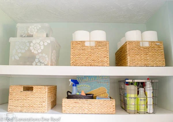DIY white wood laundry shelves, plastic storage bin, sisal baskets with paper towels , wire basket with laundry detergent