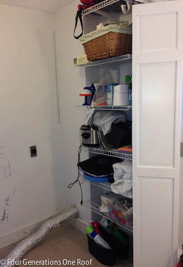 ugly white laundry closet with wire shelving and bifold doors