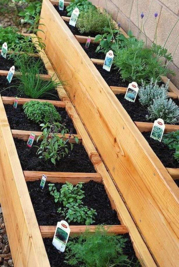 stacked-herb-beds-pressure treated wood flower beds for growing herbs