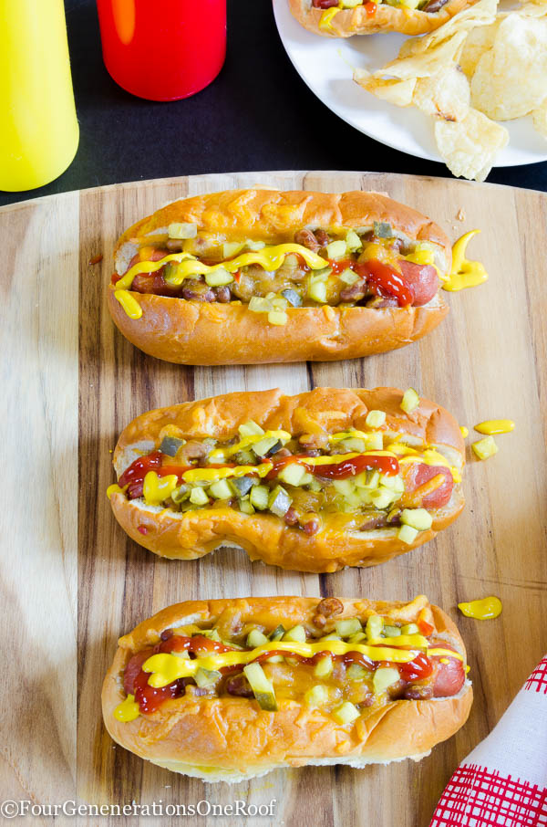 Kings Hawaiian hot dog rolls, hot dog, baked beans, cheese with butter spread on top, cookie sheet lined with tin foil, relish, ketchup