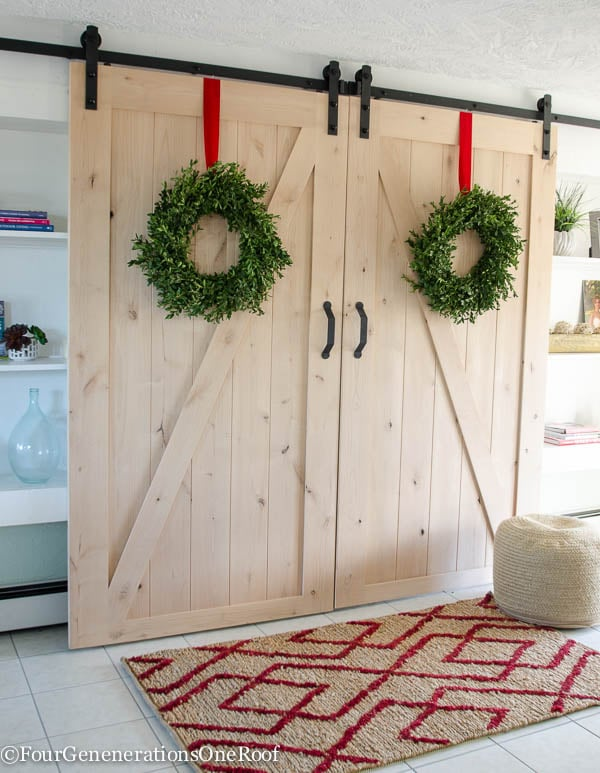 Traditional Christmas Home Tour 2015 - Our Christmas Kitchen 2015: boxwood wreaths, red velvet ribbon, boxwood Christmas tree, red striped hand towel, greens and holly berry.