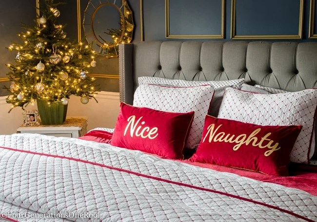 Traditional Christmas Home Tour 2015 Our Red + White Christmas bedroom featuring black and white polka dot flannel sheets, red velvet blanket, red and white diamond coverlet and black gingham checkered pillow covers