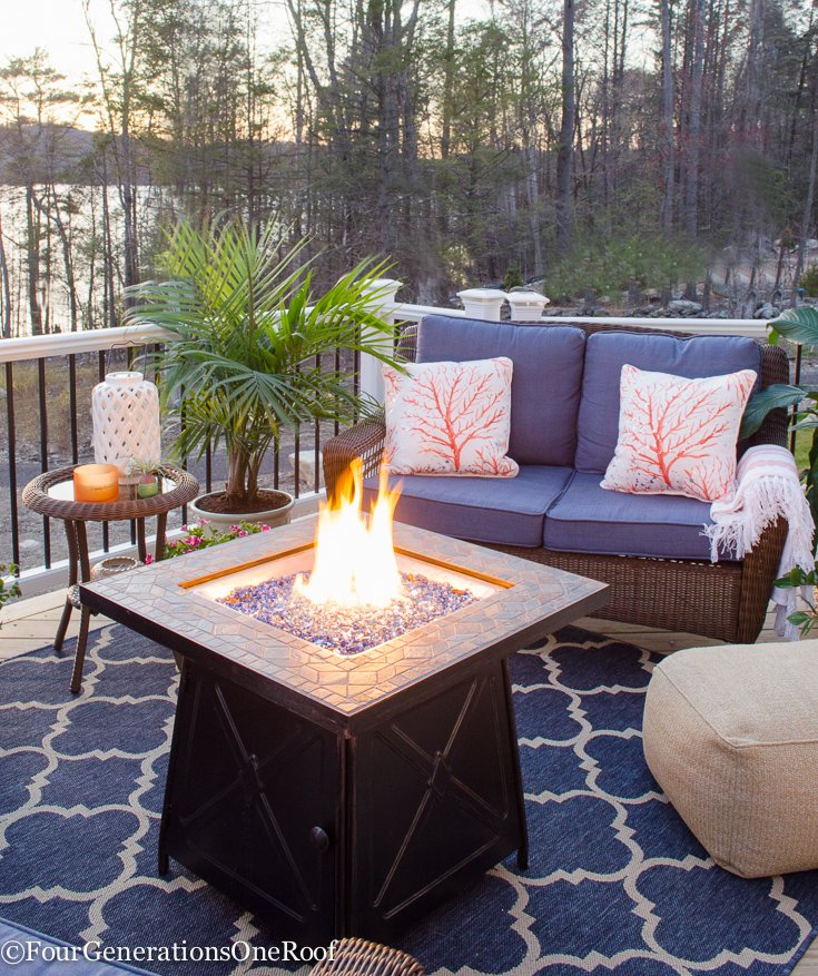Snag Outdoor Patio Furniture for Under $600  {LakeSide Deck Reveal} How to create a cozy patio or deck space with affordable wicker furniture, lots of ceramic planters and a gorgeous firepit for ambiance. #patiofurniture #patio #deckfurniture #wickerfurniture #outdoors #outdoorfurniture #curbappeal #lakeliving #decor #decorating #exterior #outdoorseating