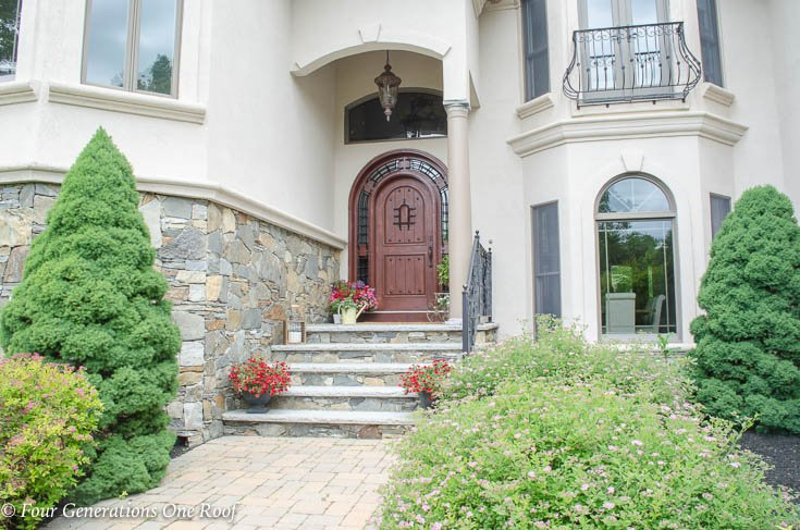 Stained arched front door summer decorating tips