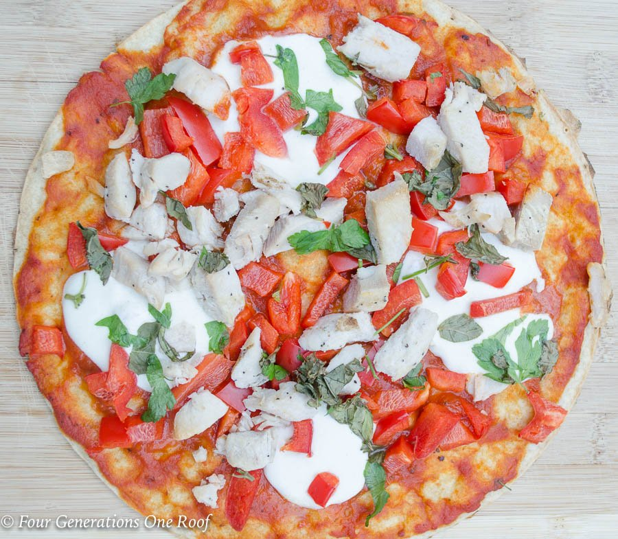 Grilled frozen cauliflower pizza crust, marinara or pasta sauce, fresh mozzarella, chicken, peppers , basil and parsley