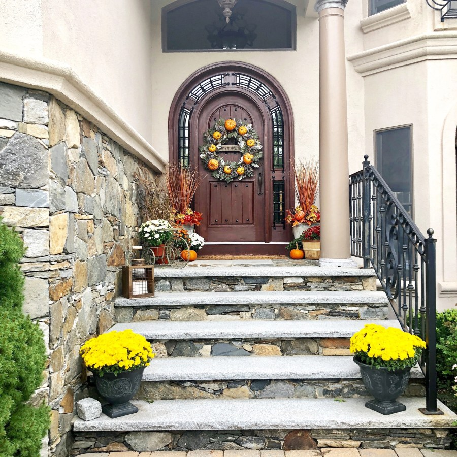 Simple Rustic Modern Fall Decor {Our Mediterranean Home Fall Tour} Grand Stained Front Door | Stone front entrance | Fall wreath |Fall decor |Curb Appeal | Flower Planters
