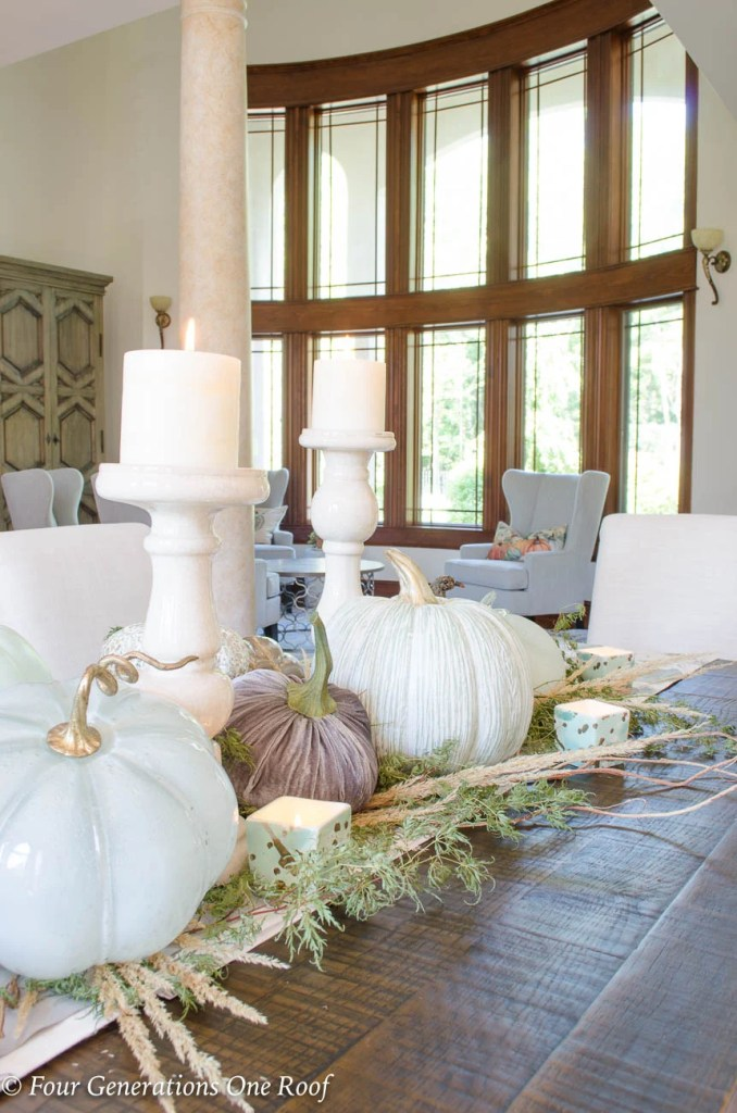 Simple Rustic Modern Fall Decor {Our Mediterranean Home Fall Tour} Neutral colored pumpkins, greenery, fall pillows and dried flowers #falldecor #rustic #modern #rusticmodern #livingroom #kitchen #diningroom #openconcept #bhg #gofinding #hgtv #sectional #diningtable #slipcoveredchair