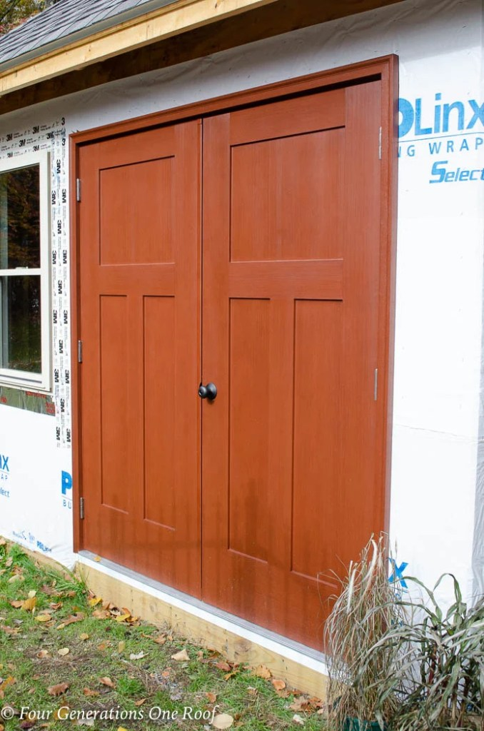 Masonite Heritage 3-Panel Craftsman Fir Textured Double Door Unit, finished with a Cherry stain in our Fortress Coatings shop