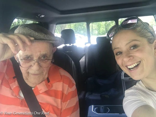 grandfather and granddaughter in car