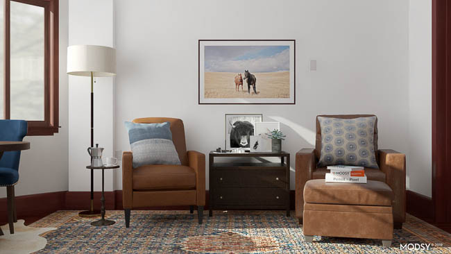 blue accent chair and table , leather chairs, equestrian wall art, ralph lauren decor, dark wood media console