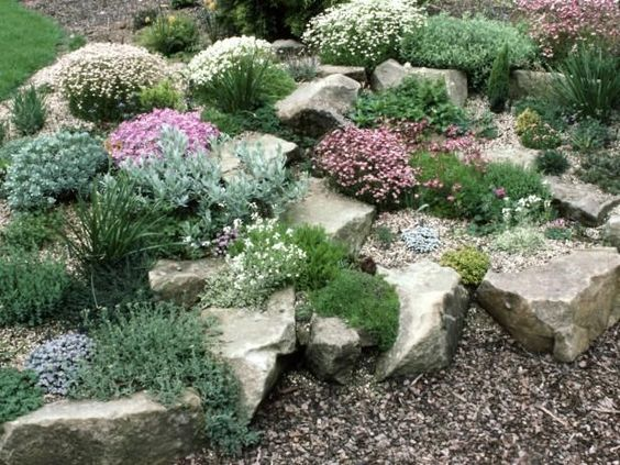 river rock and big rock garden with flowering ground covers
