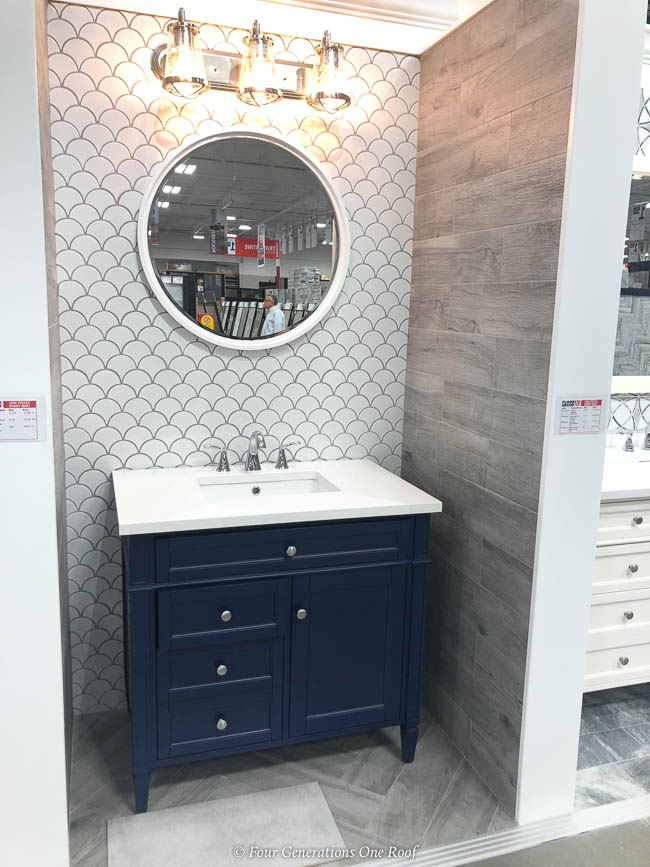 blue bathroom vanity, tiled wall
