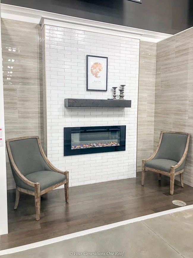 white tile wall with gas fireplace insert with wood floor tile