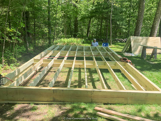 diy walk in chicken coop chicken mansion, framing the foundation, framing the walls, framing the hip roof
