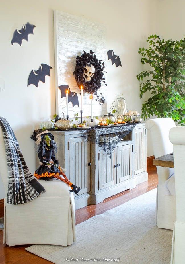 black and orange halloween cupcake table ideas + black bats + spiders + mercury pumpkins