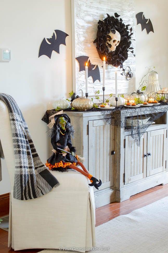 Black and Orange Halloween Table Ideas + flying halloween bats, spiders, black spider netting, witch, mercury pumpkins