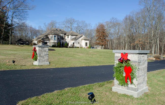 Airstone Driveway Entrance Columns with Christmas Wreath, red bow and bells, Mediterranean House