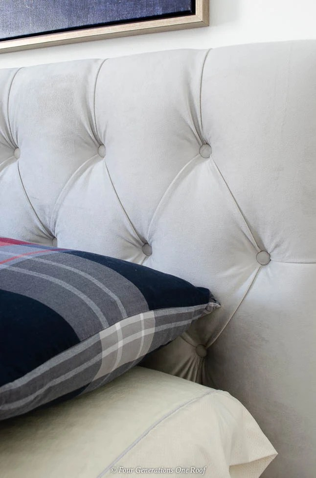Gray tufted headboard, plaid pillow case