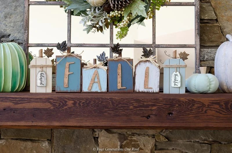 wood mantel, blue fall pumpkin wooden sign, green striped pumpkin