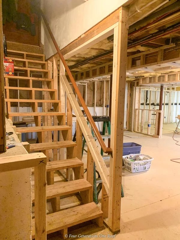 open basement stairway before balusters installed