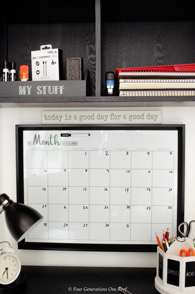 dry erase wall calendar, good day wooden sign, desk lamp, pencil holder, storage baskets, school supplies