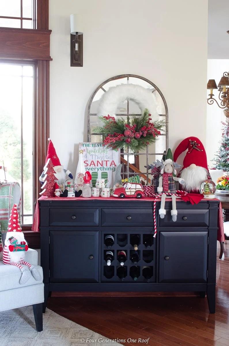 black wine cabinet, christmas wreath, hot chocolate goodies, christmas station gnomes