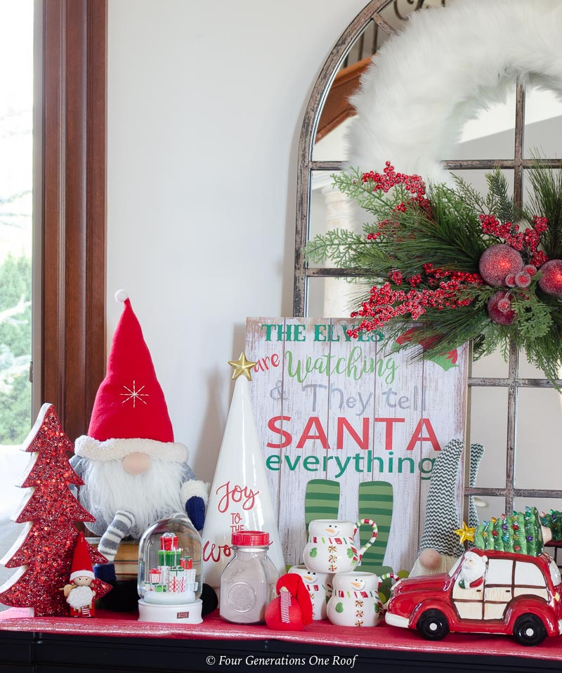 christmas station hot chocolate , gnomes, santa sign, red tree, white wreath
