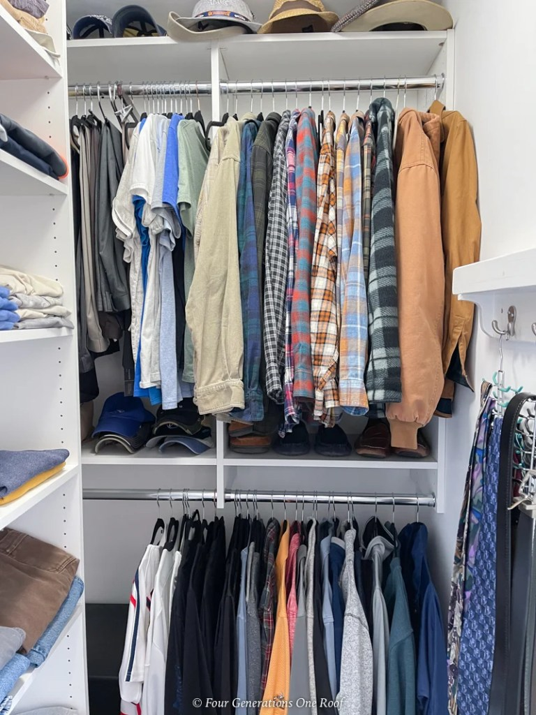 Easyclosets Walk in closet with wood shelving system for mens clothes