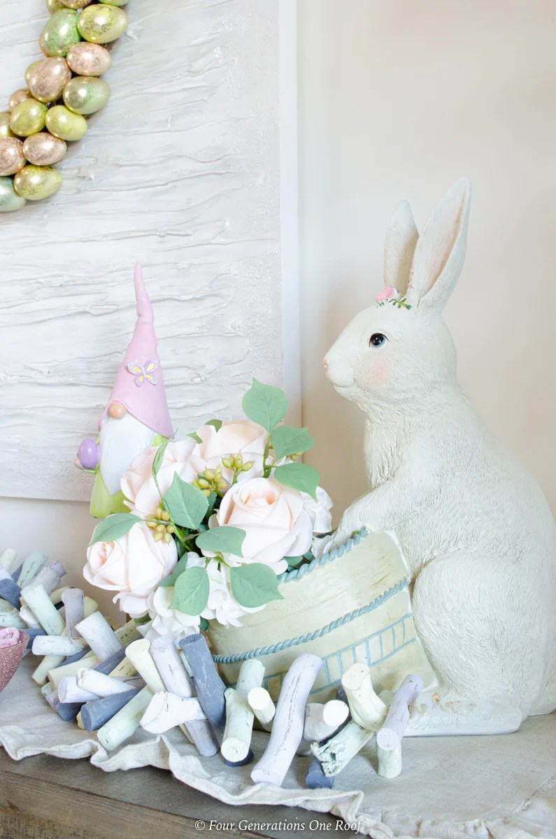 White ceramic Easter bunny planter with peach roses
