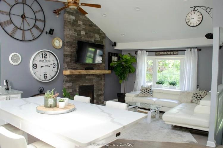 split level house open kitchen living room bay window + clock wall