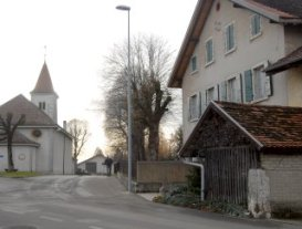 Now image: church and entry to village