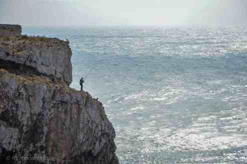 One of the fishermen in Sagres, standing on the cliffs as you do.