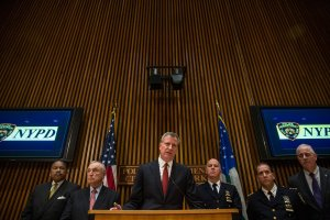 New York City Mayor Bill de Blasio speaking on the cabaret law flanked by police officials.