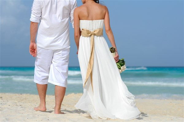 destination wedding couple on beach