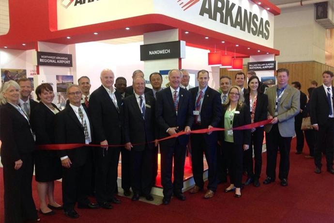 Gov. Asa Hutchinson and Arkansas delegation at Paris (France) Air Show ribbon cutting for Arkansas booth._-8276218951785627224
