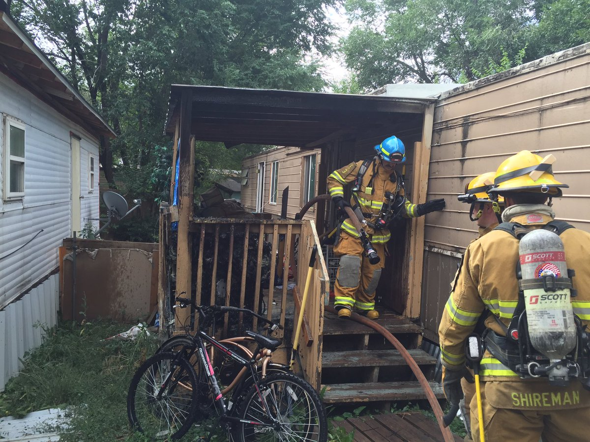 Firefighters put out a fire on the porch of a home in A-1 Mobile Village Friday morning. _ Colorado Springs Fire Department_184406