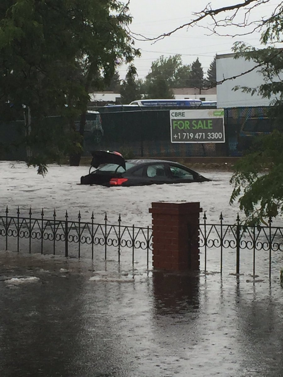 A car stranded in flooding at Platte Avenue and Tia Juana Street east of downtown Colorado Springs. _ Kalyn McMackin - FOX21 News_188962