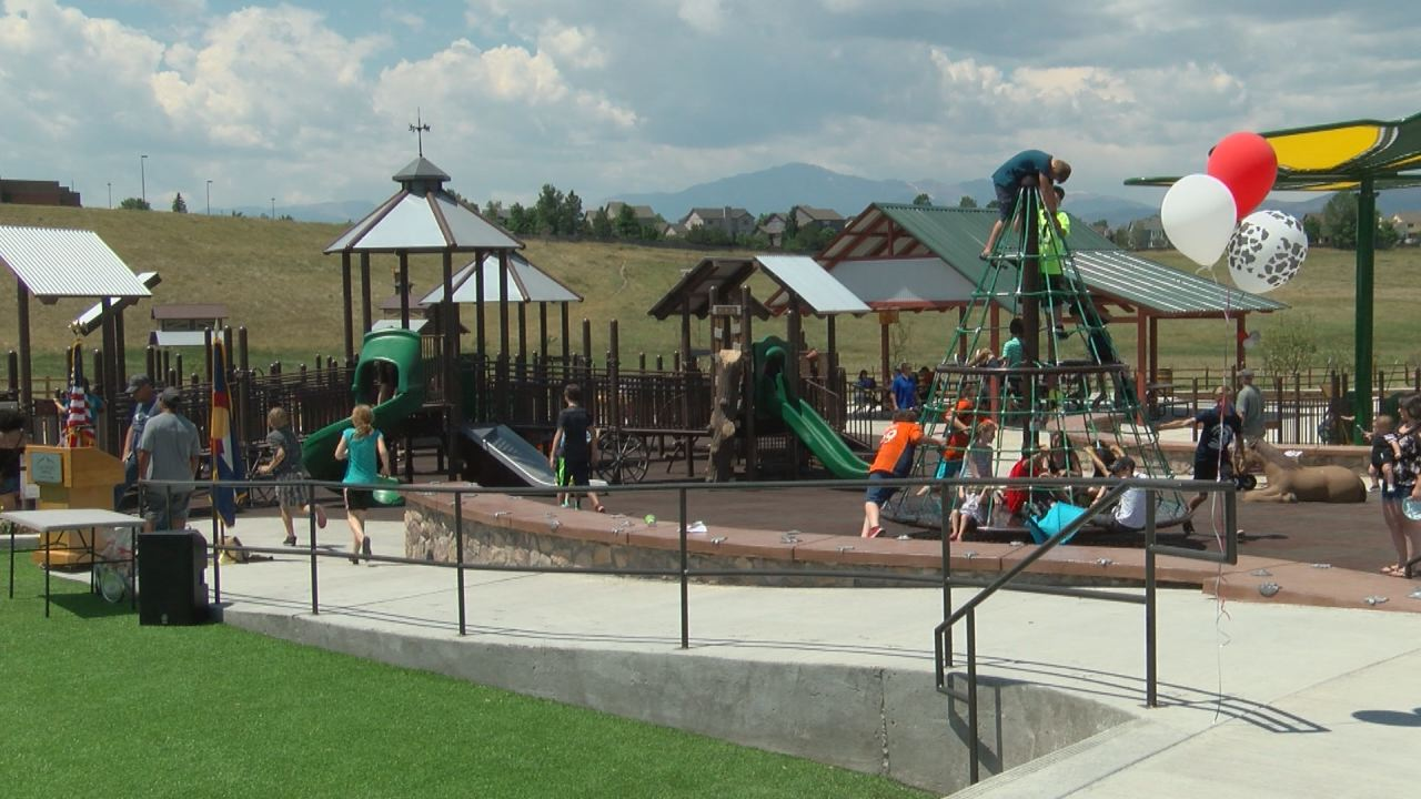 Kids playing on fully inclusive playground_285911