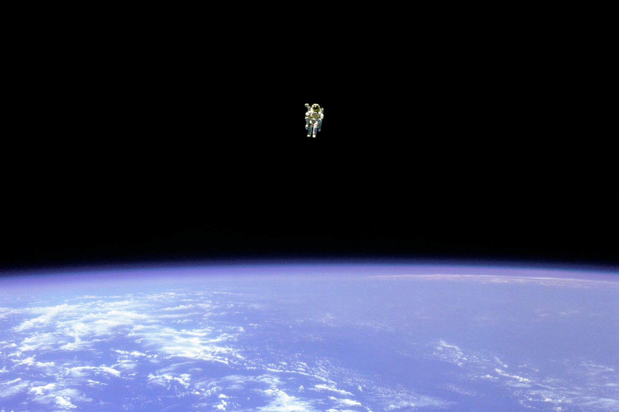 FILE - In this Feb. 12, 1984 photo made available by NASA, astronaut Bruce McCandless uses a nitrogen jet-propelled backpack, a Manned Manuevering Unit, outside the space shuttle Challenger. (NASA via AP)