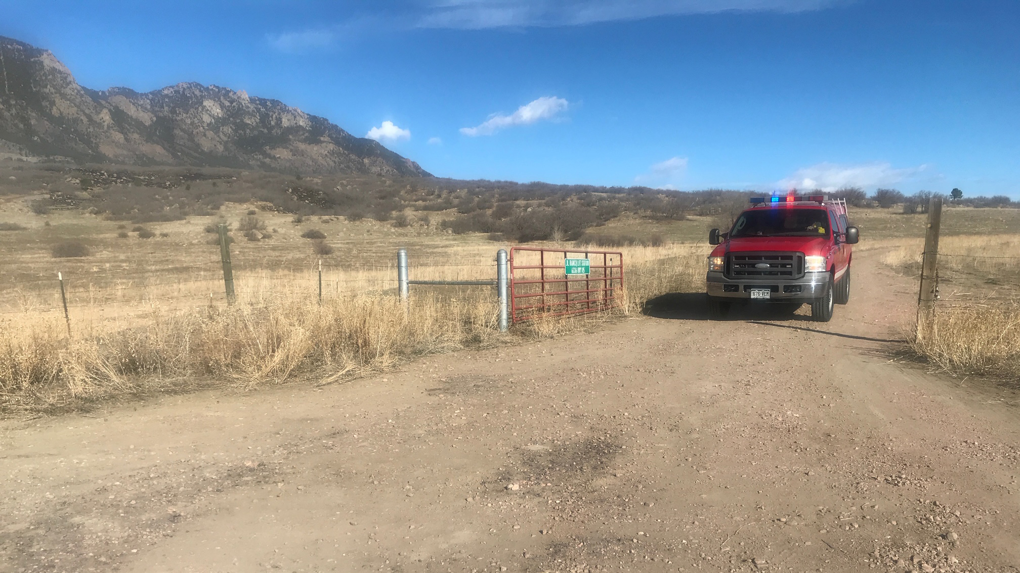 Crews are working to contain a grass fire burning near Cheyenne Mountain State Park Thursday morning. / Mike Duran - FOX21 News