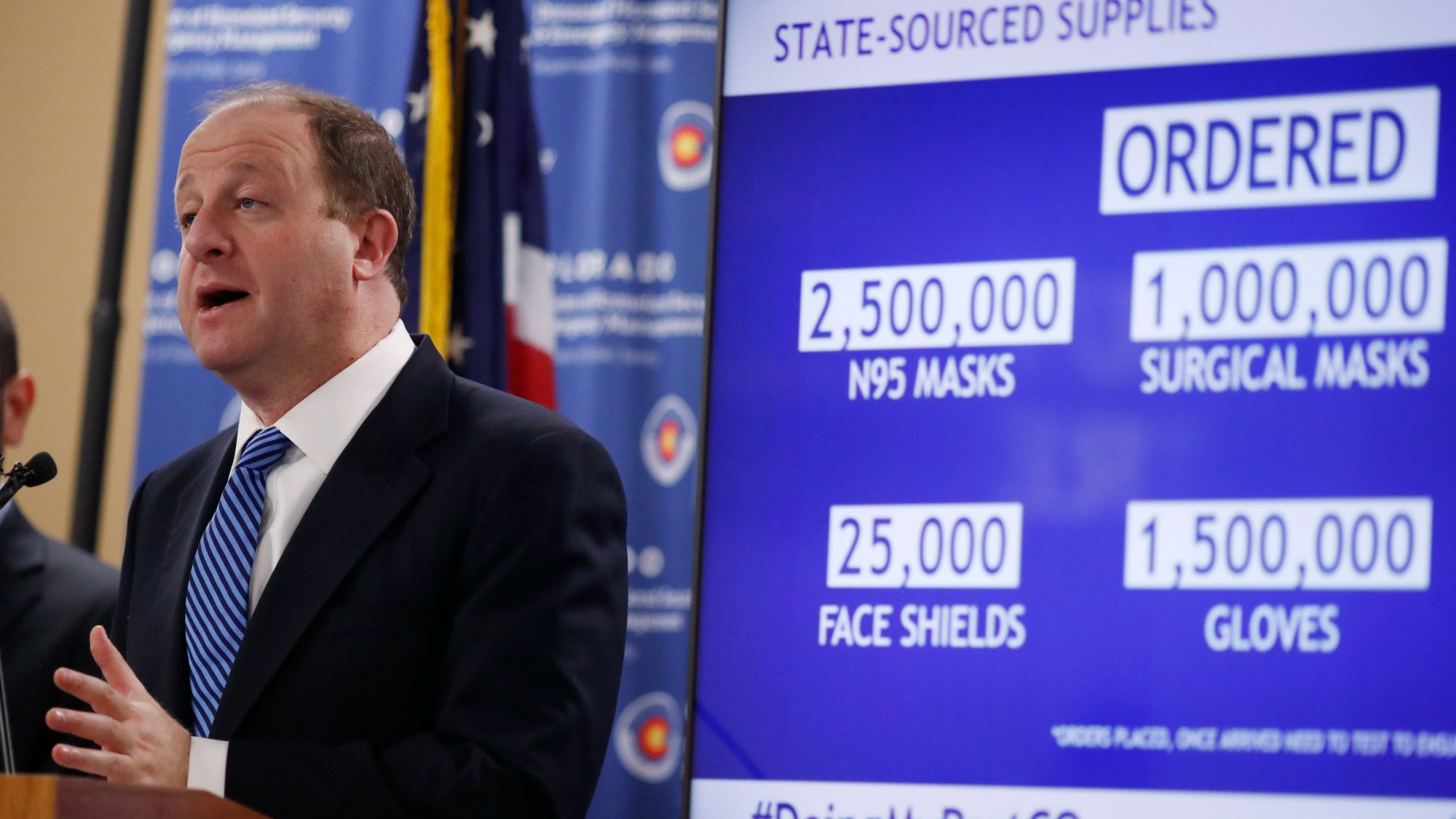 Colorado Gov. Jared Polis makes a point during a news conference as a statewide stay-at-home order remains in effect in an effort to reduce the spread of the new coronavirus Wednesday, April 1, 2020, in Centennial, Colo. (AP Photo/David Zalubowski)